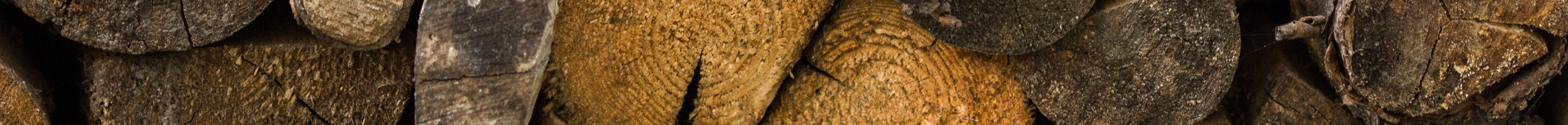 ALL FIRED UP cookie policy header image of logs stacked