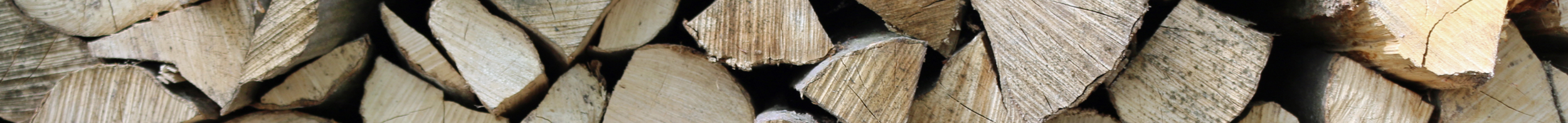 Testimonials header image of logs stacked up for ALL FIRED UP