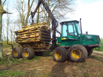 Our logs cut and stacked on our Timberjack loader ready for storing at ALL FIRED UP
