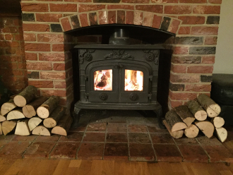 A customers wood stover burner using ALL FIRED UP quality kiln dried logs